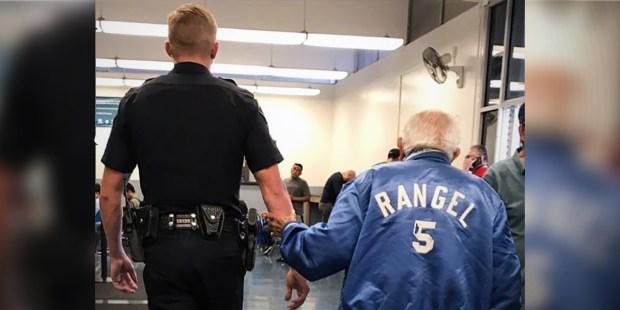 Officer Josett Helping Elder Man