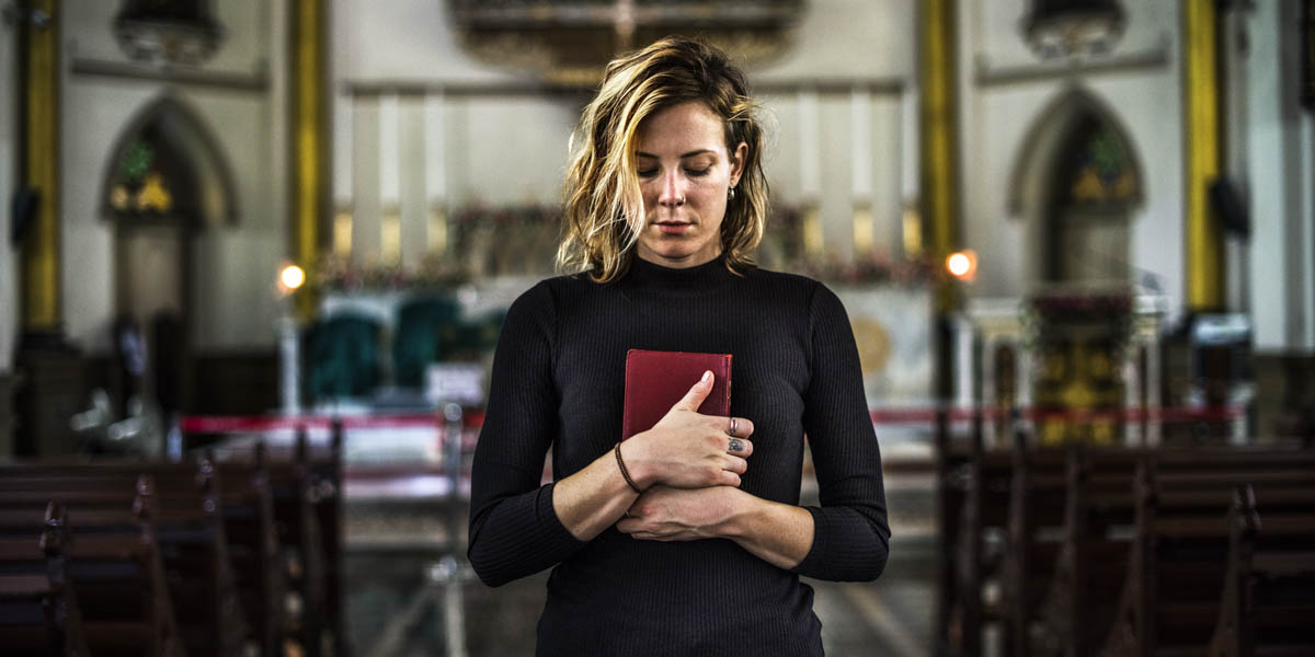 WOMAN WITH PRAYER BOOK