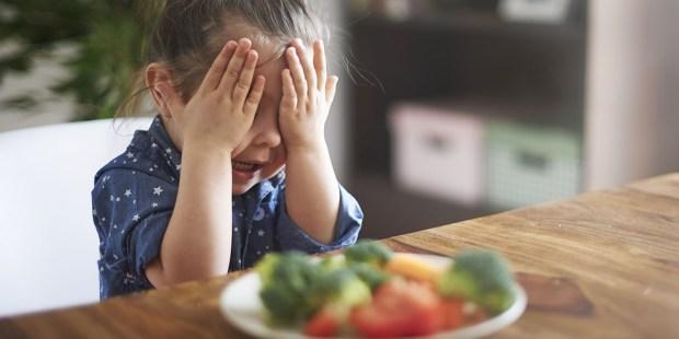 Girl eating Veggies