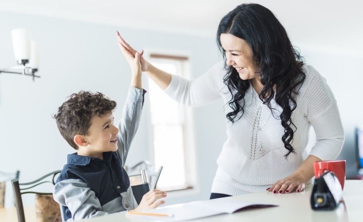 Son and mom doing homework