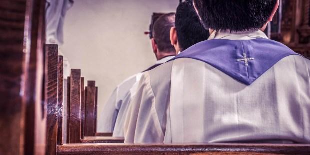 PRIEST IN PEWS
