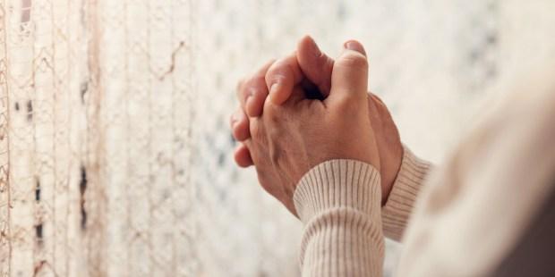 WOMAN,HANDS,PRAYER