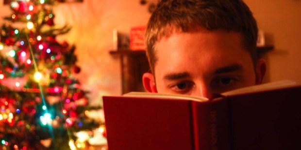 MAN READING,CHRISTMAS TREE