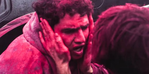 MAN COVERED IN PINK DUST