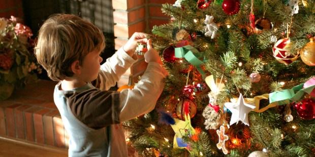 LITTLE,BOY,DECORATES,CHRISTMAS,TREE