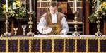 PRIEST WEARING VESTMENT