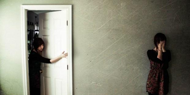 GIRL IN HALLWAY,GIRL LOOKING OUT OF DOOR