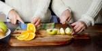 WOMEN SLICING FRUIT