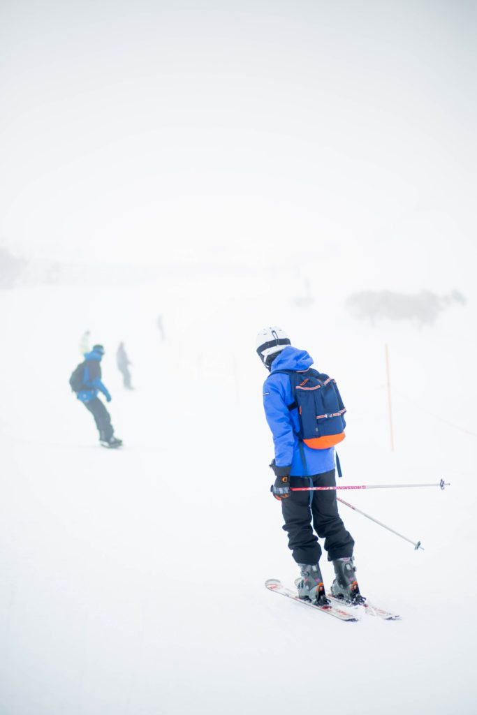 SKIERS ON A HILL