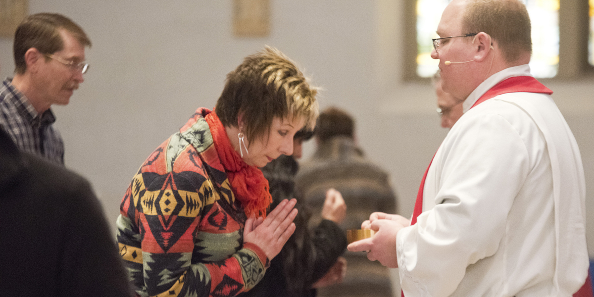 WOMAN,PRIEST,COMMUNION