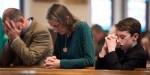 PEOPLE PRAYING IN CHURCH
