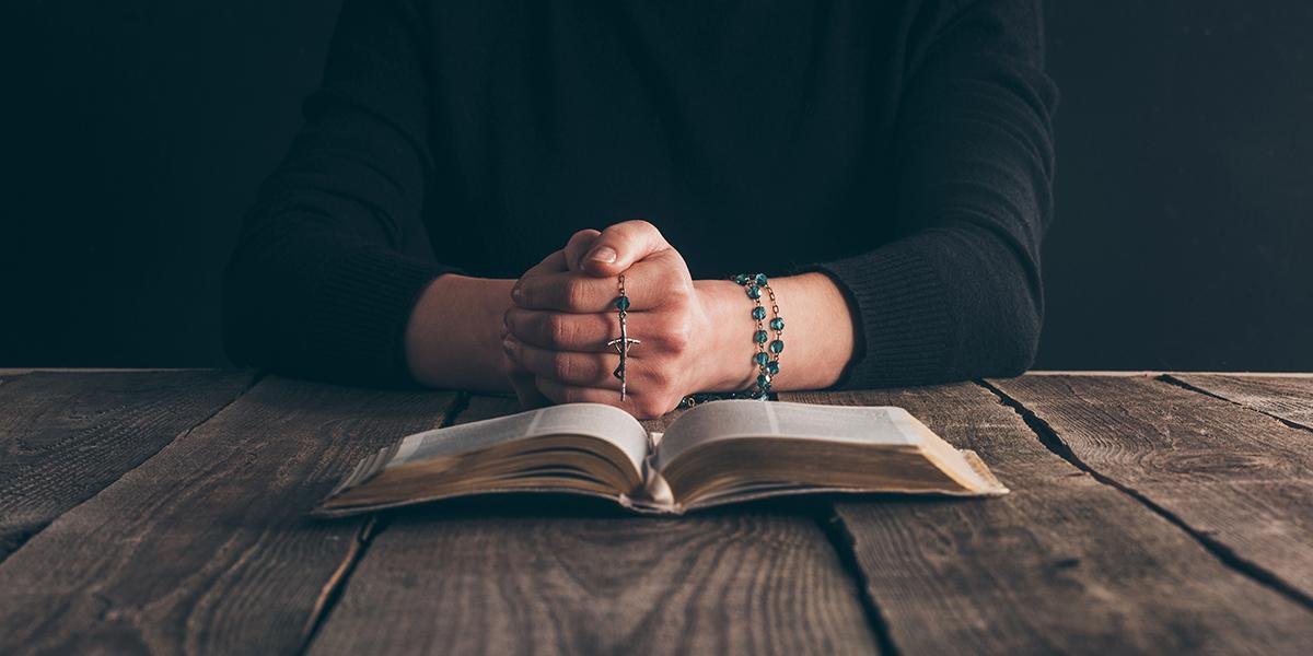 Woman Praying rosary