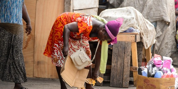 AFRICAN,WOMAN,BENDS,OVER