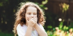 CHILD COVERING MOUTH