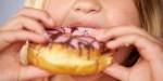 CHILD,EATING,DONUT