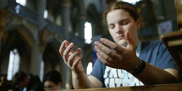 GIRL PRAYING CHURCH