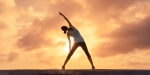 WOMAN,STRETCHING,SUNSET