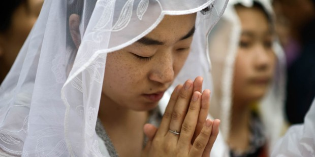 YOUNG KOREAN WOMAN PRAYING