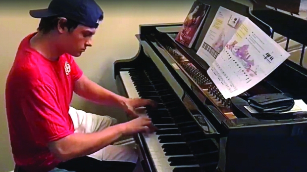Delivery boy playing piano