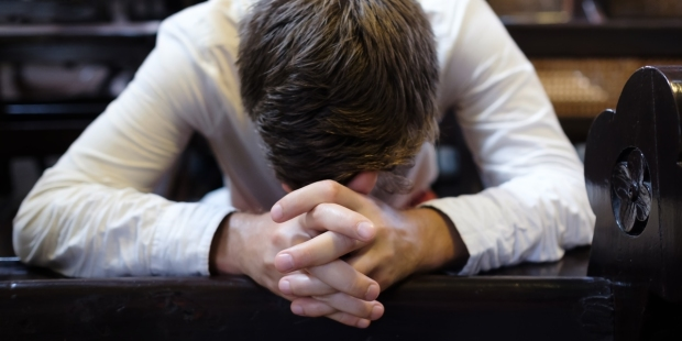 MAN,PRAYING,CHURCH