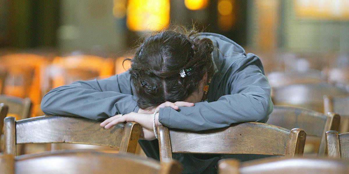 WOMAN,PRAYING,CHURCH
