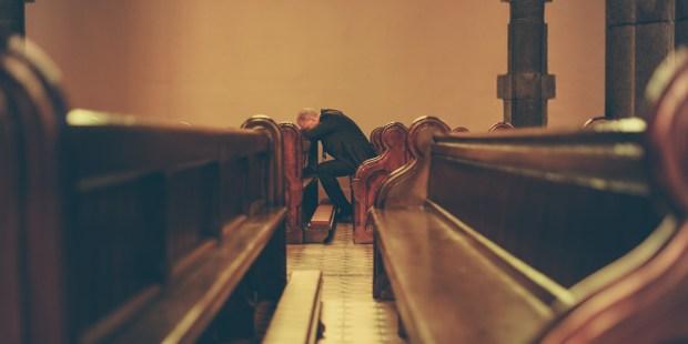 MAN,PRAYING,CHAPEL