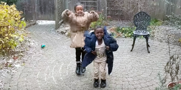 REFUGEE CHILDREN SEE SNOW