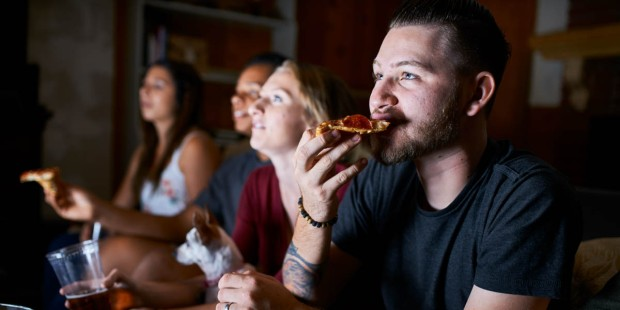 YOUNG FRIENDS WATCHING MOVIE,EATING PIZZA