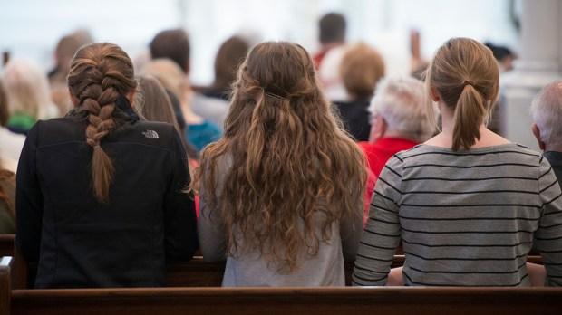 Young Woman Praying at Mass