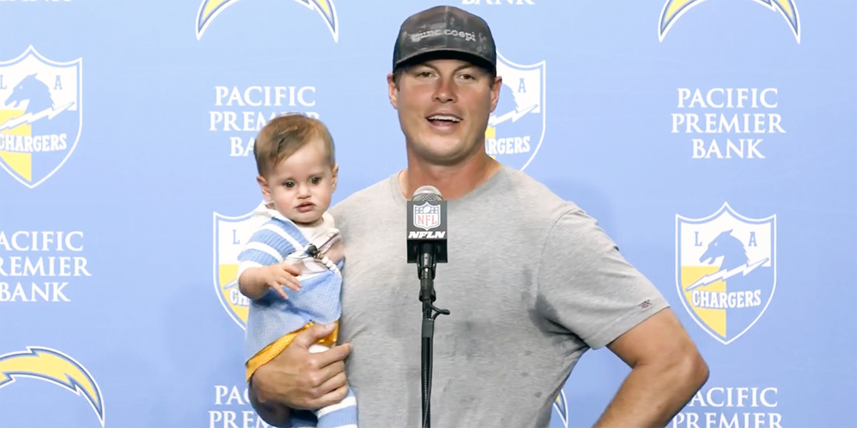 Quarterback Philip Rivers Holds Press Conference With Baby Number 9 In His Arms