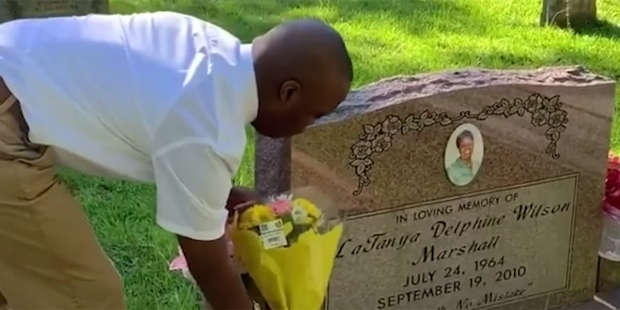 CHILD VISITING MOTHER'S GRAVE