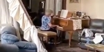 ELDERLY WOMAN PLAYING PIANO IN BERIUT