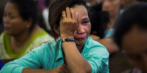 WEB2-PRAY-CRY-WOMAN-MYANMAR-AFP-000_14R2AN.jpg