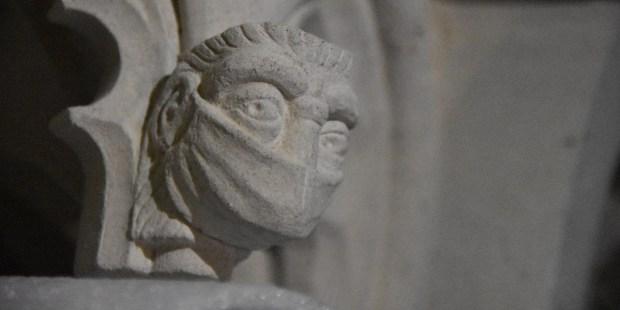 MASKED FIGURE AT THE SHRINE OF ST. AMPHIBALUS