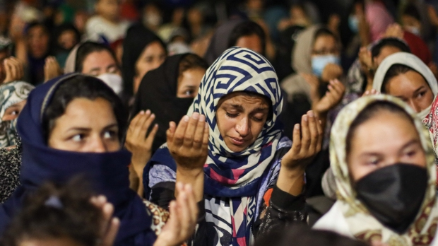 Women Refugees Pray On The Roads Of Lesbos Island